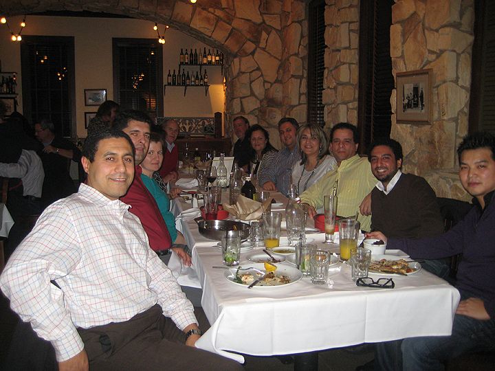 Company President Sam Abdelfattah (front left) celebrates a successful 2013 with a dinner for the staff and wives